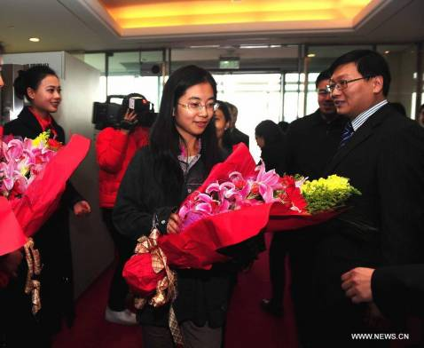 Freed Chinese workers arrive in Beijing