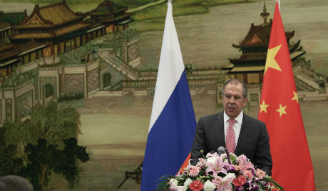 Chinese, Russian FMs pledge joint efforts for political solution to Syrian issue